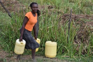 The Water Project: Chombeli Community, Ernest Kuta Spring -  Josephine Carrying Water