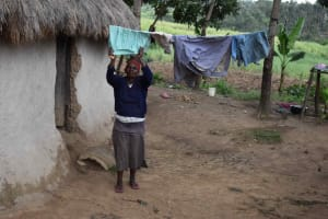 The Water Project: Chombeli Community, Ernest Kuta Spring -  Mama Prince Airing Clothes