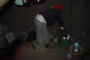 The Water Project: Chombeli Community, Ernest Kuta Spring -  Mama Prince Fetching Water