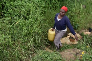 The Water Project: Chombeli Community, Ernest Kuta Spring -  Mama Rosa Carrying Water