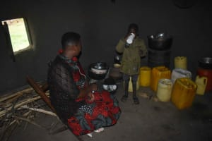 The Water Project: Chombeli Community, Ernest Kuta Spring -  Silas Drinking