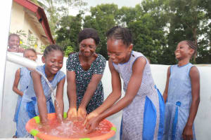 The Water Project: Shepherd Foundation, New Apostolic Church and Primary School -  Head Teacher And Students Happily Splashing
