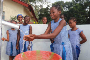 The Water Project: Shepherd Foundation, New Apostolic Church and Primary School -  Student Happily Drinking