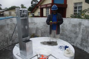 The Water Project: Shepherd Foundation, New Apostolic Church and Primary School -  Checking Levels Of The Well