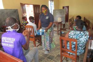 The Water Project: Shepherd Foundation, New Apostolic Church and Primary School -  Facilitator Showing Handwashing Method