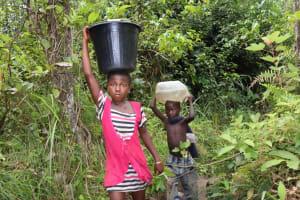 The Water Project: Kamasondo, Mayeamy Village -  Kids Carrying Water