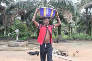 The Water Project: Rosint, Cassava Farm, Makuta Oil Palm Garden -  Young Boy Carrying Water