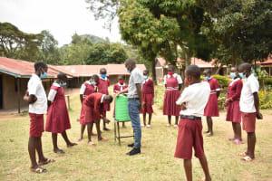The Water Project: Gimariani Primary School -  Demonstrating Handwashing