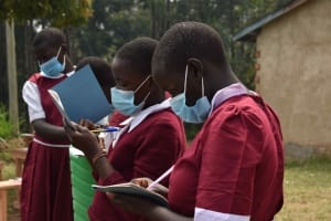 The Water Project: Gimariani Primary School -  Students Taking Notes