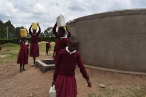 The Water Project: Gimariani Primary School -  Students Carrying Water