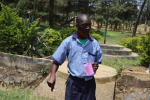 The Water Project: Ebukuya Special School for the Deaf -  Student Brushing Teeth