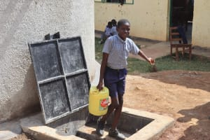 The Water Project: Ebukuya Special School for the Deaf -  Students Carrying Water