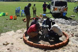 The Water Project: Shamberere Boys' High School -  Pump Stand Fixing