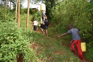 The Water Project: Shivakala Community, Mukangu Spring -  Carrying Water