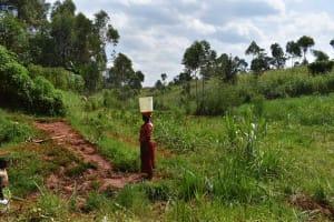 The Water Project: Shivakala Community, Mukangu Spring -  Florence Heading Home