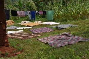 The Water Project: Shivakala Community, Mukangu Spring -  Airing Clothing