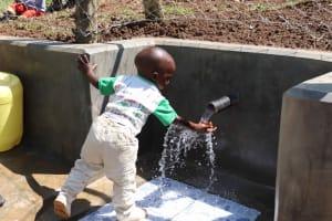 The Water Project: Nangurunya Community, Robert Musali Spring -  A Child Enjoying Water