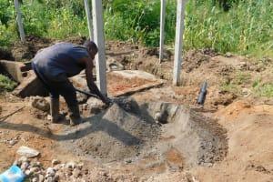 The Water Project: Nangurunya Community, Robert Musali Spring -  Cement Work
