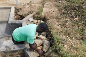 The Water Project: Nangurunya Community, Robert Musali Spring -  Backfilling With