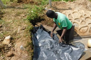 The Water Project: Nangurunya Community, Robert Musali Spring -  Backfilling With Plastic