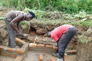 The Water Project: Nangurunya Community, Robert Musali Spring -  Wall Construction