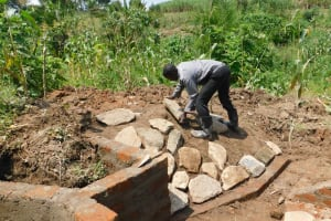 The Water Project: Nangurunya Community, Robert Musali Spring -  Stone Pitching