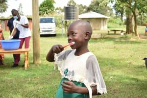 The Water Project: Nangurunya Community, Robert Musali Spring -  A Girl Brushing Her Teeth