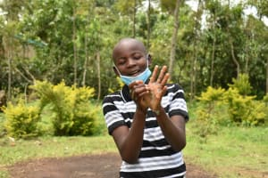 The Water Project: Nangurunya Community, Robert Musali Spring -  Allan Demonsrating Handwashing