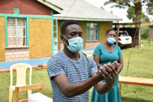 The Water Project: Nangurunya Community, Robert Musali Spring -  Demonsrating Handwashing
