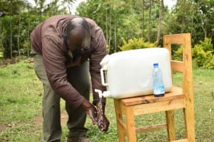 The Water Project: Nangurunya Community, Robert Musali Spring -  Participant Practices Handwashing