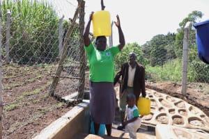 The Water Project: Nangurunya Community, Robert Musali Spring -  Carrying Water