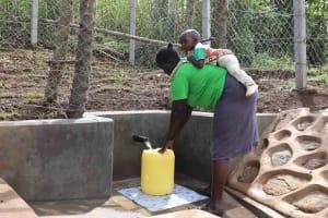 The Water Project: Nangurunya Community, Robert Musali Spring -  Collecting Water
