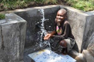 The Water Project: Bukhakunga Community, Wakukha Spring -  Girl Splashing