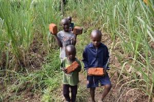 The Water Project: Bukhakunga Community, Wakukha Spring -  Children Bringing Bricks