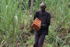 The Water Project: Bukhakunga Community, Wakukha Spring -  Michael Brings Bricks