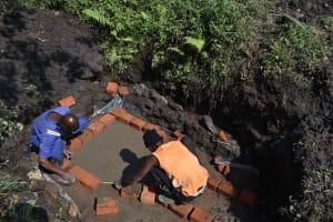 The Water Project: Bukhakunga Community, Wakukha Spring -  Brick Setting