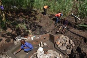 The Water Project: Bukhakunga Community, Wakukha Spring -  Community Members Helping