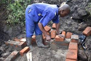 The Water Project: Bukhakunga Community, Wakukha Spring -  Wall Construction