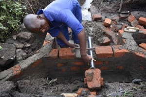 The Water Project: Bukhakunga Community, Wakukha Spring -  Pipe Setting