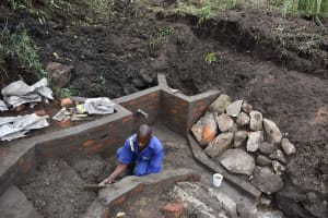 The Water Project: Bukhakunga Community, Wakukha Spring -  Plastering Stairs
