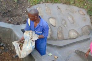 The Water Project: Bukhakunga Community, Wakukha Spring -  Backfilling Clay