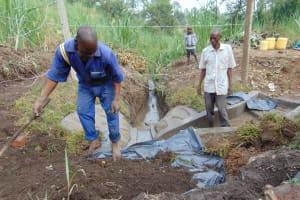 The Water Project: Bukhakunga Community, Wakukha Spring -  Backfilling Mound