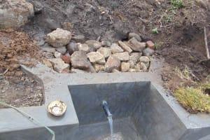 The Water Project: Bukhakunga Community, Wakukha Spring -  Backfilling Stone