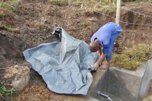 The Water Project: Bukhakunga Community, Wakukha Spring -  Backfilling Tarp
