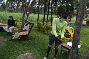 The Water Project: Bukhakunga Community, Wakukha Spring -  Trying Handwashing