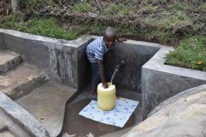 The Water Project: Bukhakunga Community, Wakukha Spring -  Filling A Jerrycan
