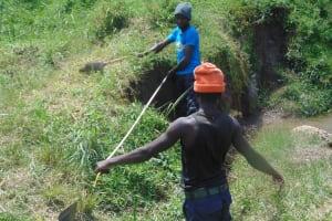 The Water Project: Shamoni Community, Shiundu Spring -  Measuring For Excavation