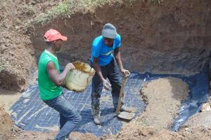 The Water Project: Shamoni Community, Shiundu Spring -  Slab Setting