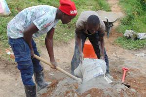 The Water Project: Shamoni Community, Shiundu Spring -  Mixing Mortar