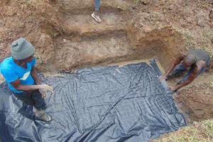 The Water Project: Shamoni Community, Shiundu Spring -  Setting Foundation